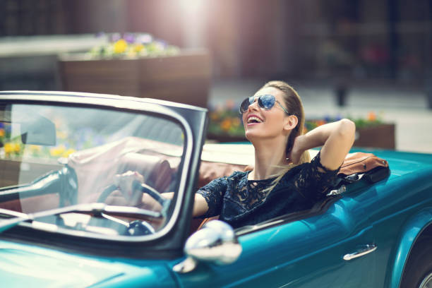 fashion woman model in sunglasses sitting in luxury retro car - affluent lifestyle stock pictures, royalty-free photos & images