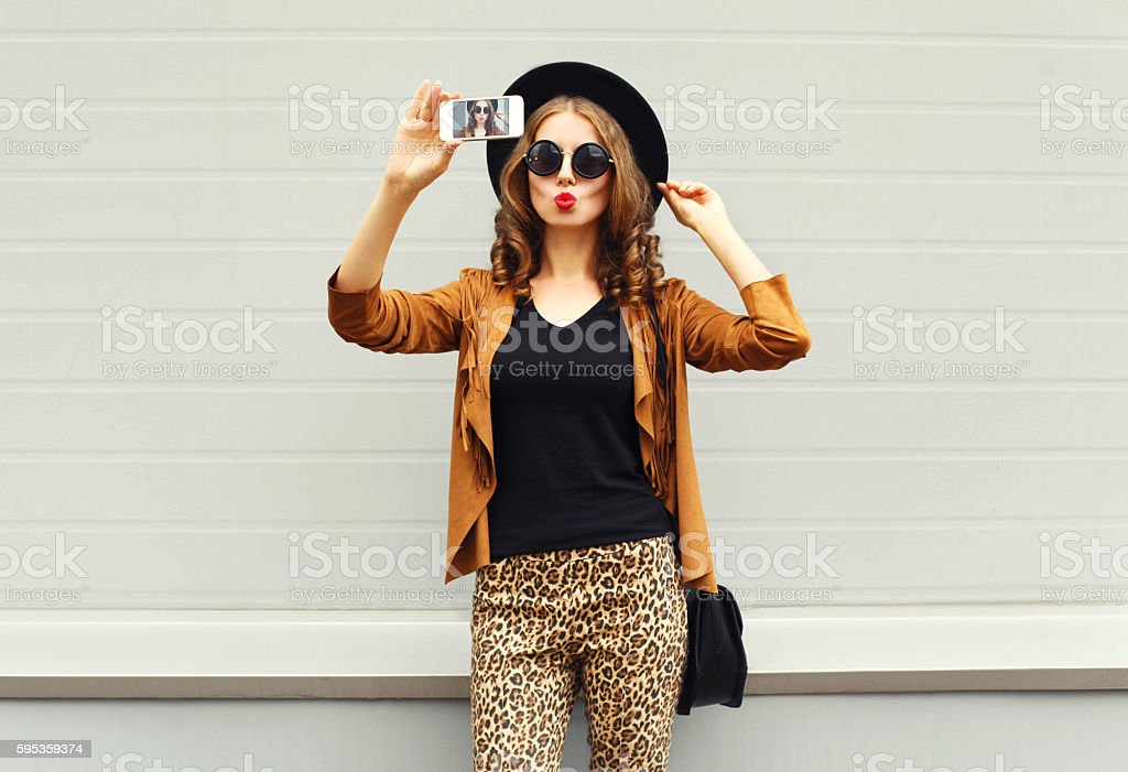 Fashion woman model taking photo picture self-portrait on smartphone stock photo