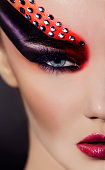 half of woman portrait with fantasy makeup.