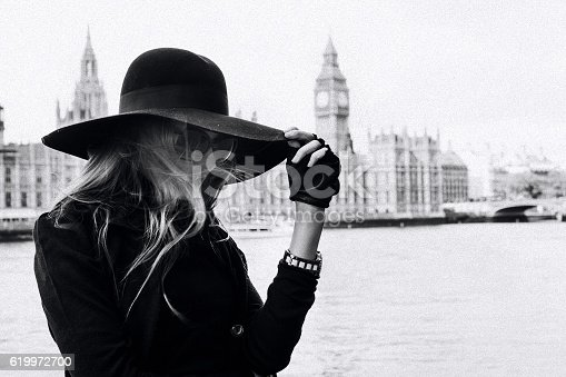 Young sexy woman in London city. black and white photo grain added
