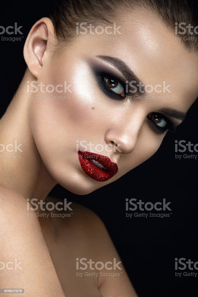 Fashion woman portrait on black background with red lips. stock photo