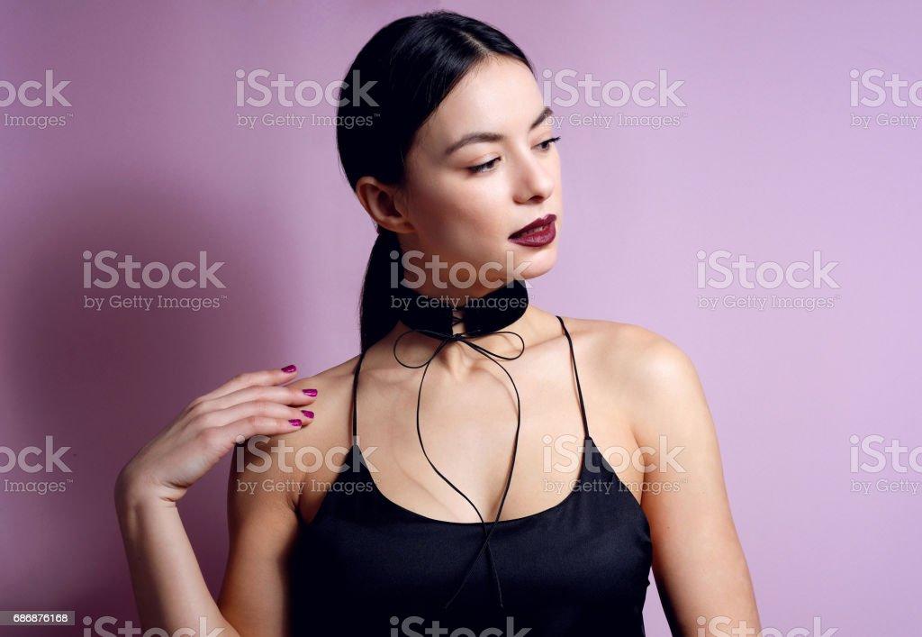 Fashion woman sensual lips with black choker bow accessory. стоковое фото
