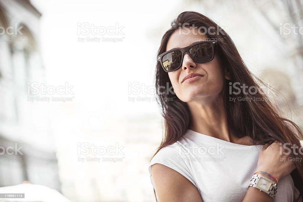 Fashion woman smiling on the city royalty-free stock photo
