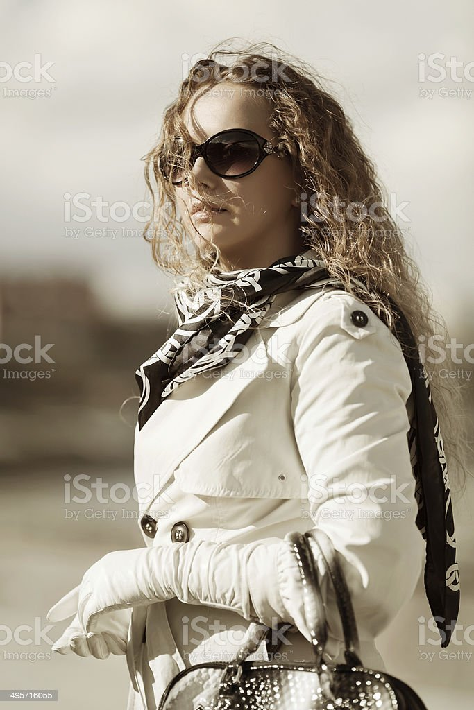 Fashion woman with long curly hairs stock photo