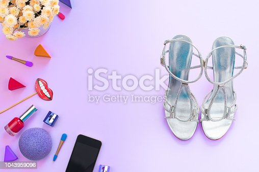 455111881istockphoto Fashion women accessories cosmetics shoes gadget mobile flowers on purple background Top view flat lay copy space 1043959096