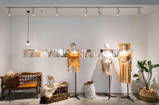 Fashion women's clothes in shopping mall windows