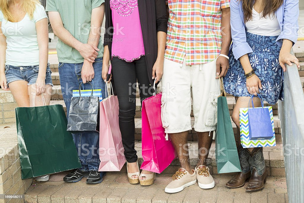 Fashion: Young adults outdoors during shopping trip stock photo