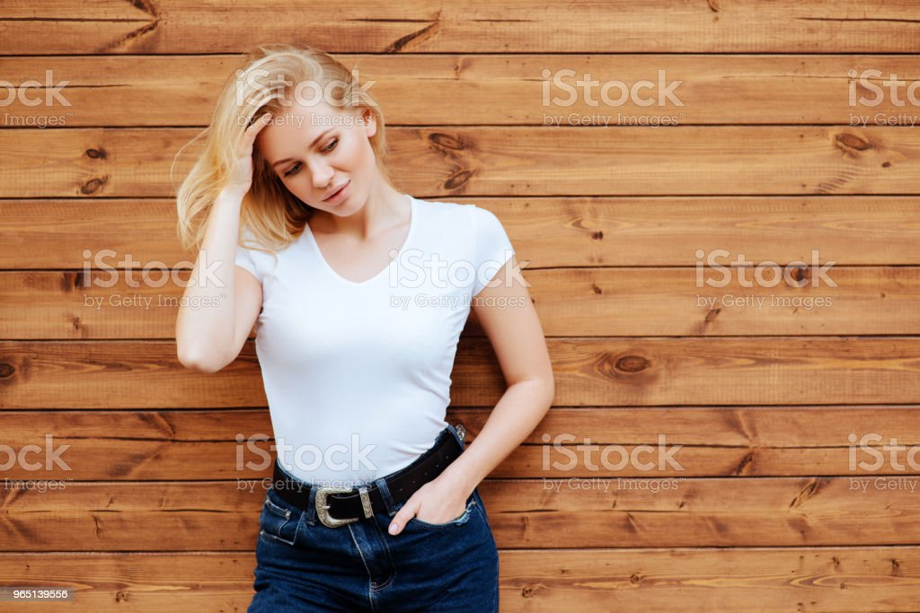 Fashion young blonde woman over wooden background zbiór zdjęć royalty-free