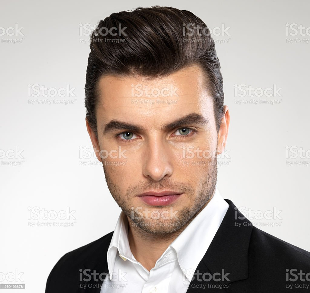 Fashion young businessman in black suit stock photo