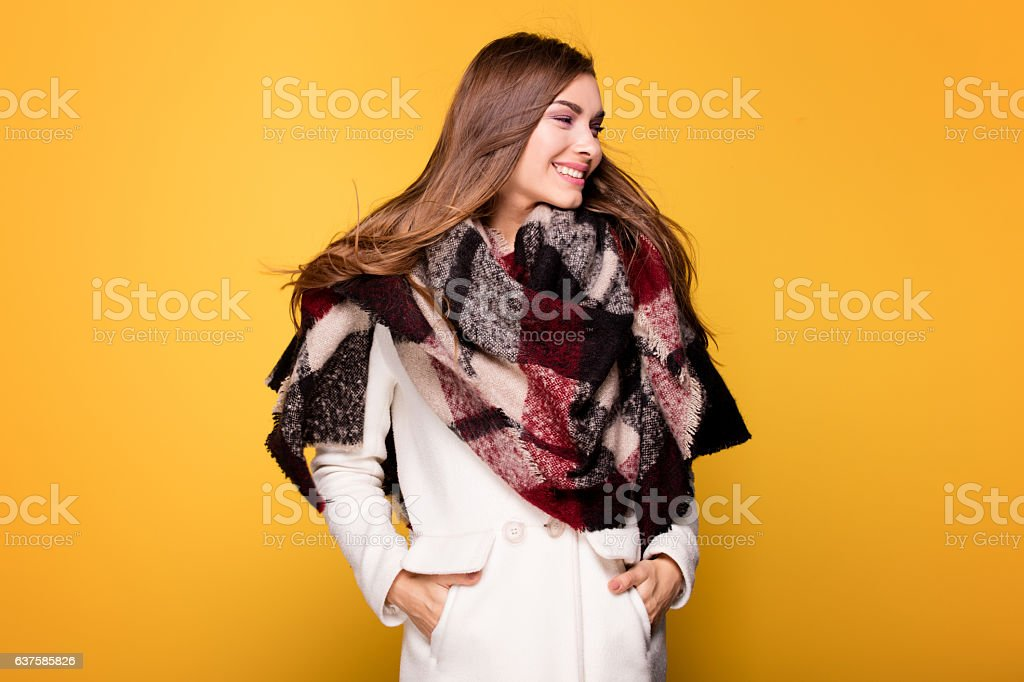 Fashion young model posing in coat. stock photo