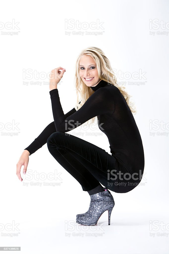 Fashion, young woman, ankle boot, black trousers and turtleneck stock photo