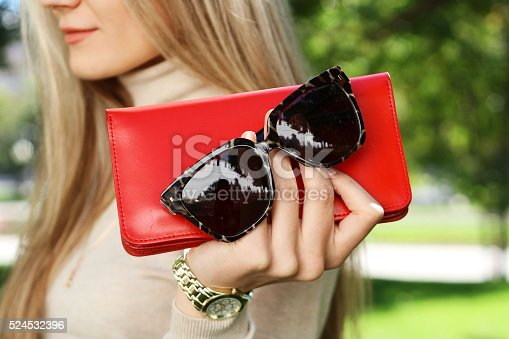 509923232 istock photo fashion young woman holding red purse clutch in hand autumn 524532396