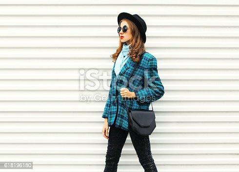 istock Fashion young woman wearing black hat checkered coat jacket handbag 618196180