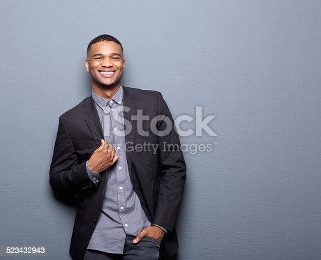 825083570 istock photo Fashionable african american man smiling 523432943