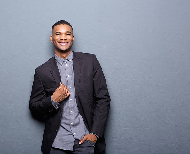 fashionable african american man smiling - preppy fashion stock photos and pictures