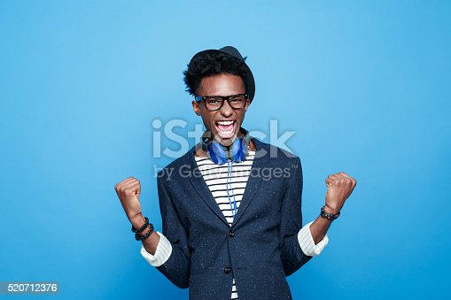 istock Fashionable afro american guy expressing happiness 520712376