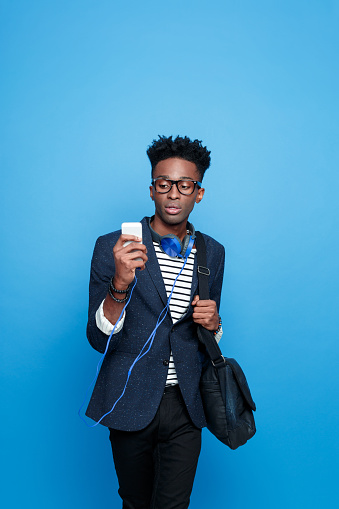 Fashionable Afro American Guy Using A Smart Phone Stock Photo - Download Image Now