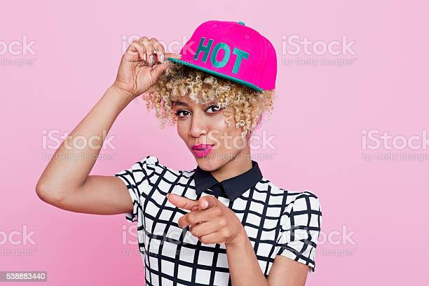 Fashionable Afro American Woman Pointing With Index Finger Stock Photo - Download Image Now