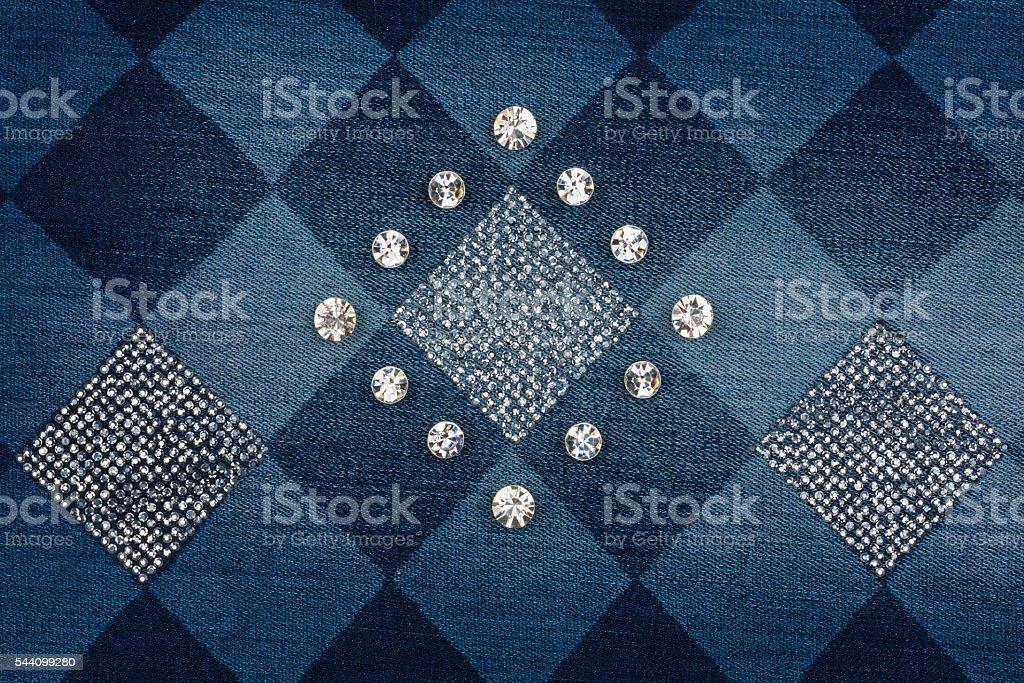 Fashionable background, jeans inlaid rhinestones stock photo