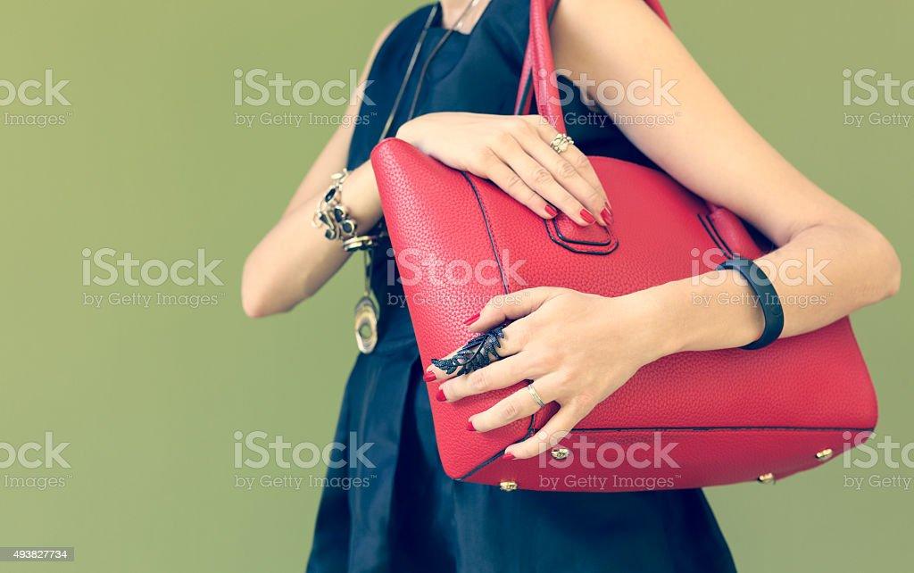 Fashionable beautiful big red handbag on a shoulder stock photo