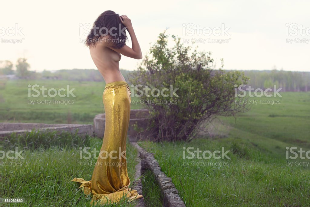 Fashionable beautiful young woman with tissue in field. Portrait of beautiful young lady, copy space background стоковое фото