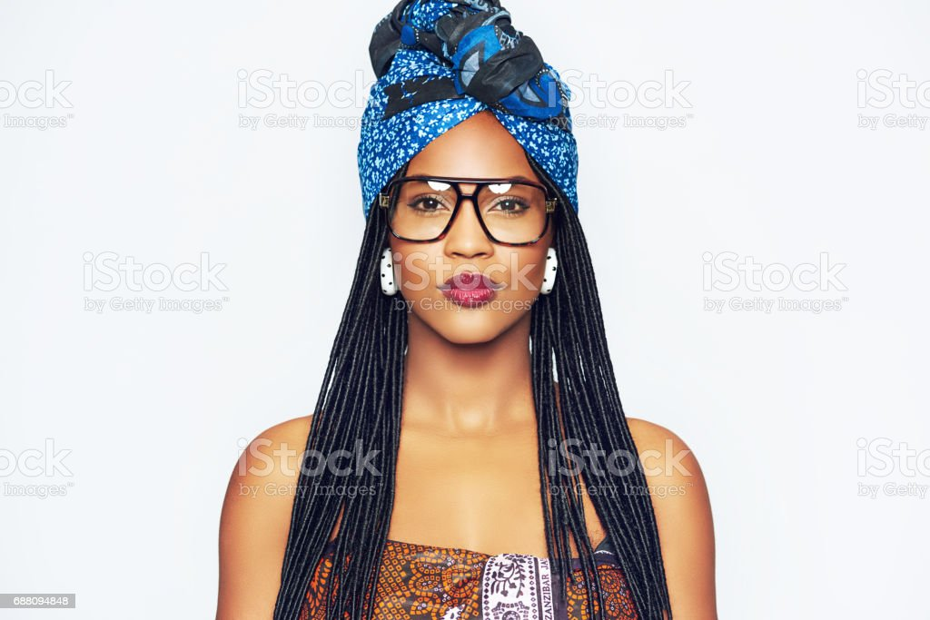 Fashionable black woman in ethnic clothes stock photo