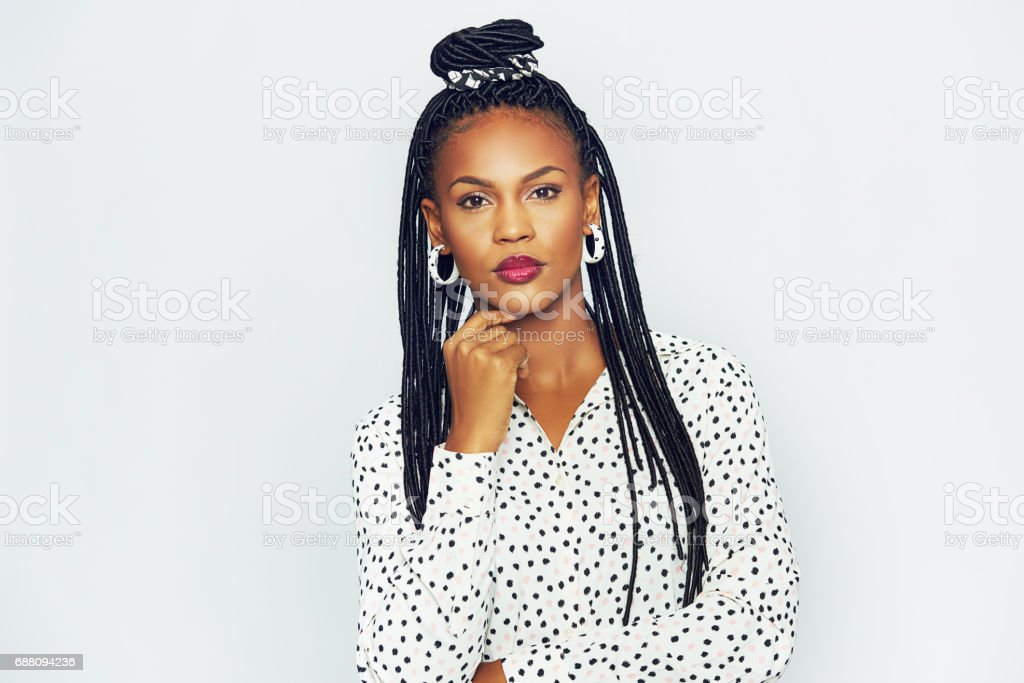 Fashionable black woman with long braided hair stock photo