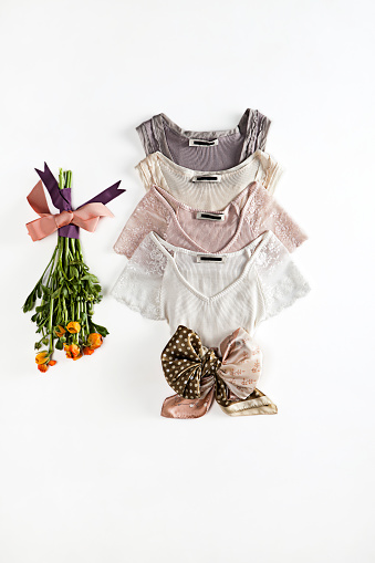 Fashionable blouses with flowers on white background