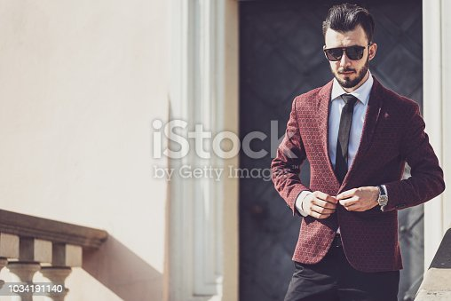 907934274 istock photo Fashionable businessman outdoors 1034191140