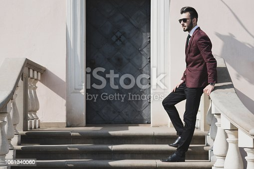 907934274 istock photo Fashionable businessman outdoors 1061340060