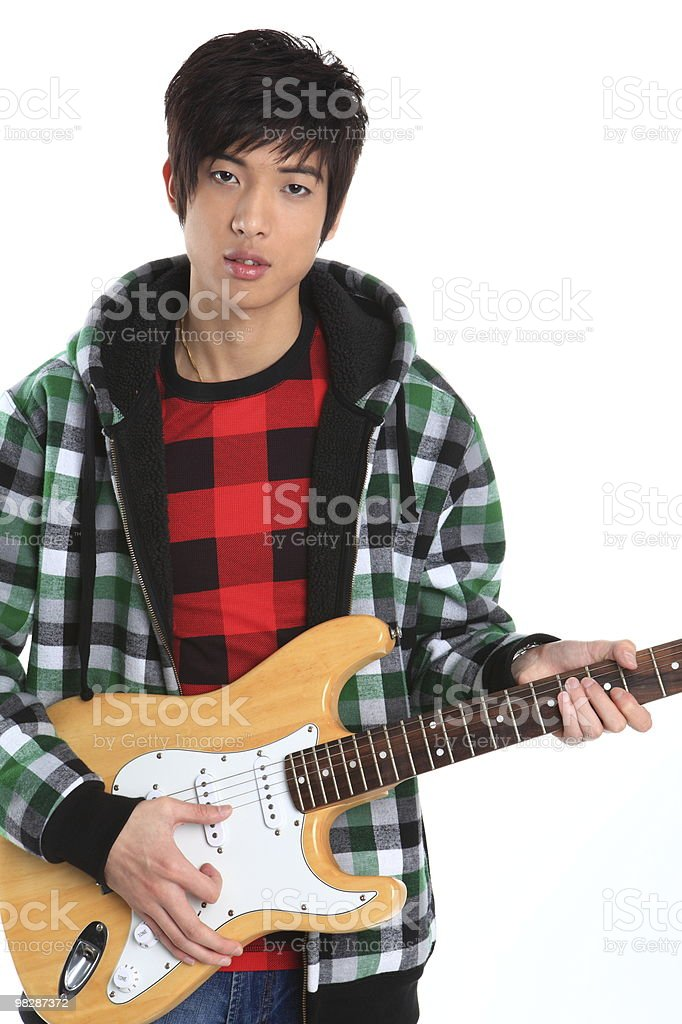Fashionable Chinese boy play the guitar royalty-free stock photo
