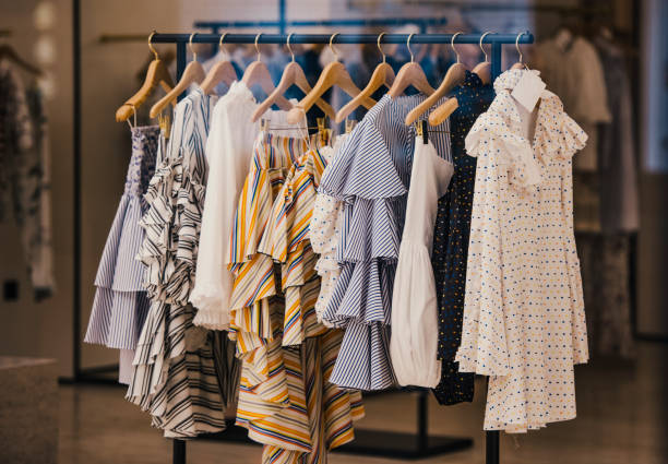 Fashionable clothes in a boutique store in London. - foto stock
