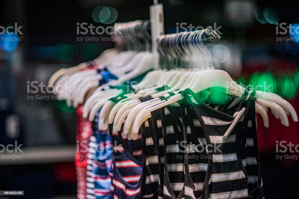 Fashionable clothes in a boutique store. Lizenzfreies stock-foto