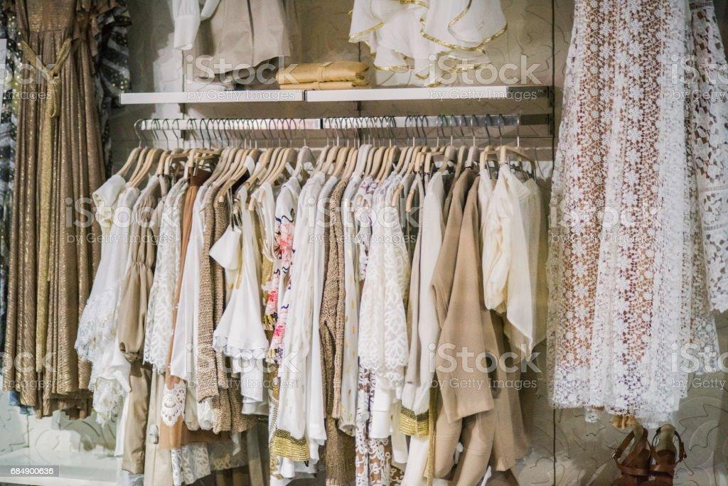 Fashionable clothes in a boutique store. Lizenzfreies stock-foto