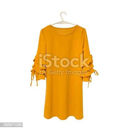 Fashionable concept. Mustard dress on white background