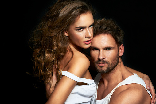 Fashionable Couple Posing At Sudio Stock Photo - Download Image Now