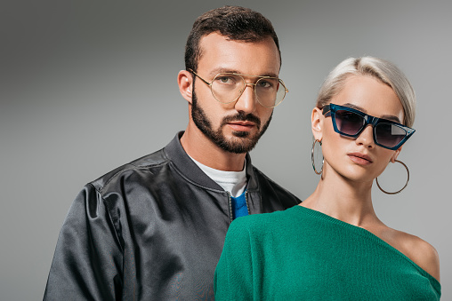 Fashionable Couple Posing In Eyeglasses And Sunglasses Isolated On ...