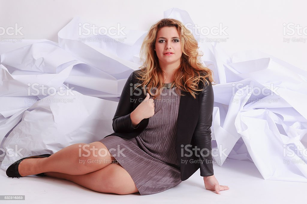 Fashionable, elegant woman with voluptuous curves in a dress. stock photo