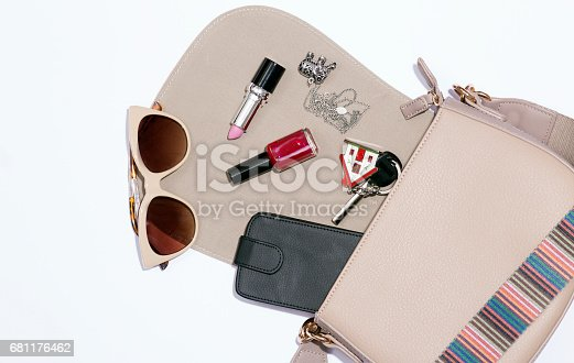 539853444 istock photo Fashionable female accessories in bag 681176462