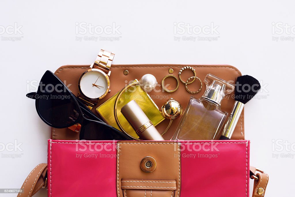 Fashionable female accessories. Overhead of essentials stock photo