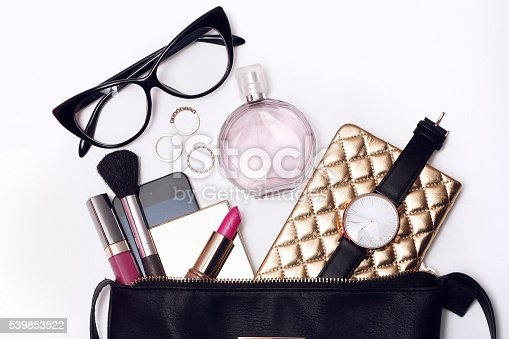 istock Fashionable female accessories watch glasses perfume 539853522