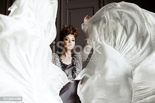 istock Fashionable female portrait of cute lady in dress indoors 1013884088