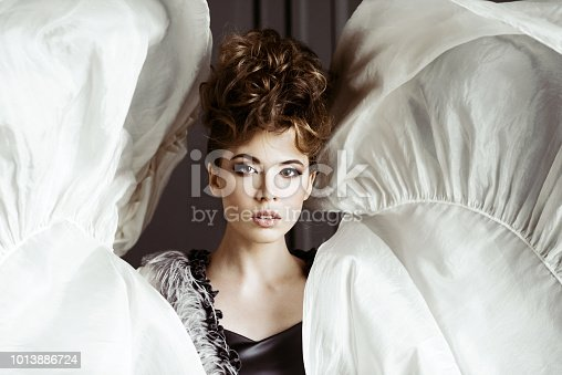 506798692istockphoto Fashionable female portrait of cute lady in dress indoors 1013886724