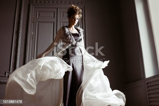 istock Fashionable female portrait of cute lady in dress indoors 1013891476