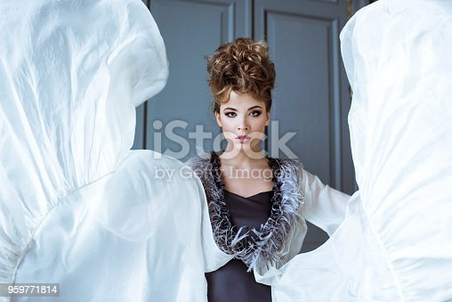 506798692istockphoto Fashionable female portrait of cute lady in dress indoors 959771814