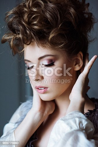 istock Fashionable female portrait of cute lady in dress indoors 959775660