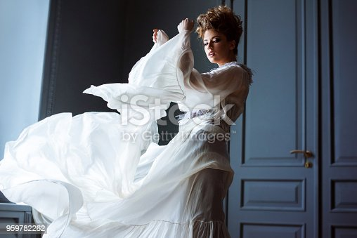 istock Fashionable female portrait of cute lady in dress indoors 959782262