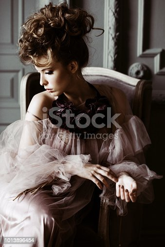 istock Fashionable female portrait of cute lady in pink dress indoors 1013896454