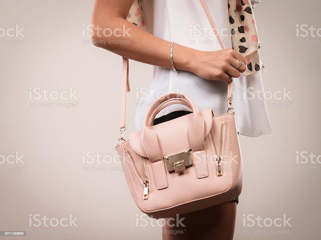 Fashionable girl holding bag handbag. stock photo