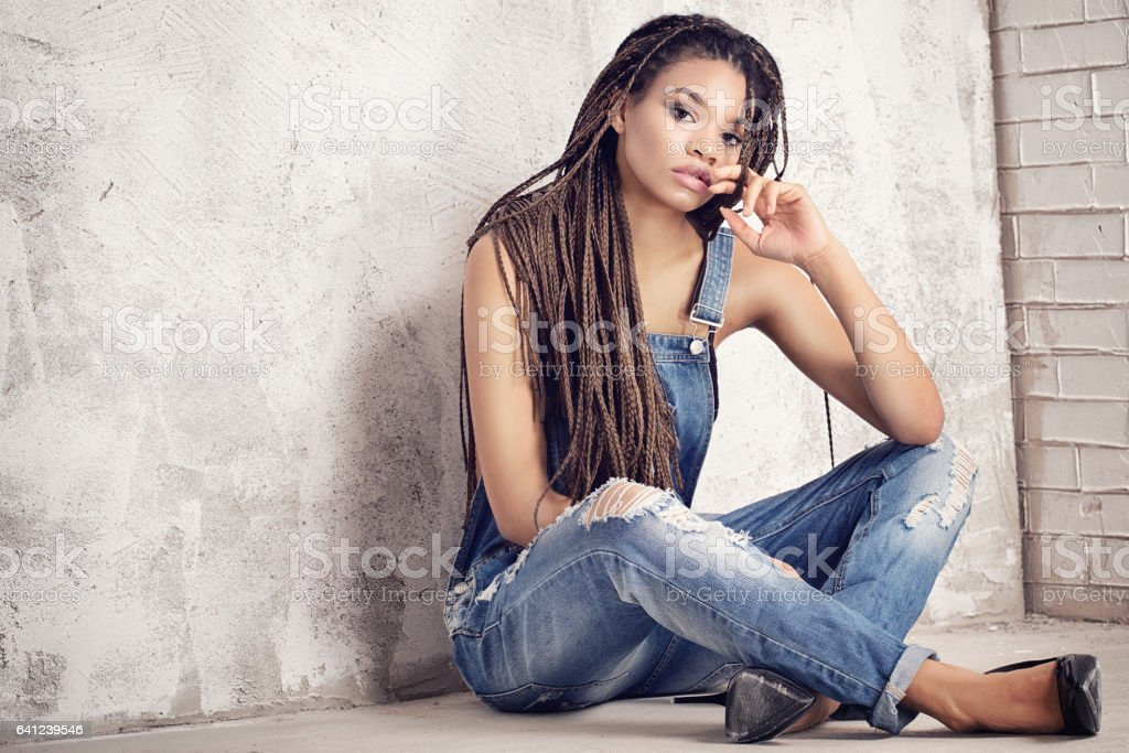 Fashionable girl in jeans. stock photo